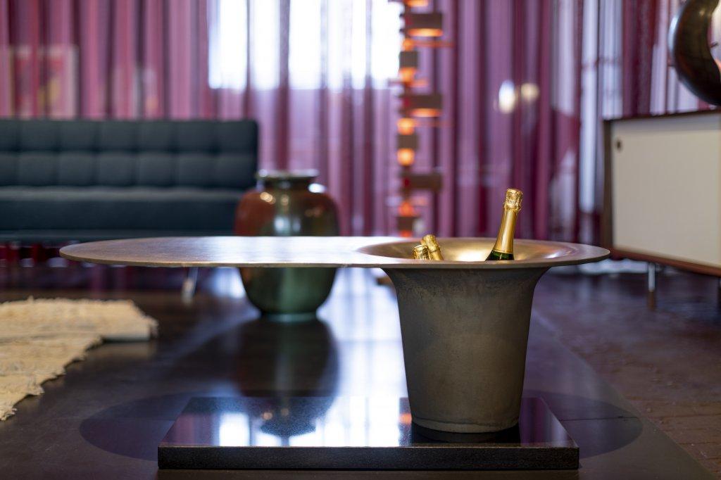 The Champagne table, solid brass, stone base, produced by AB M&E Ohlssens Klockgjuteri & Glen Baghurst, designed by Glen Baghurst